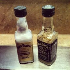 Used old Jack Daniel's mini bottles & turned them into Salt & Pepper shakers(: Rinsed them out really good & let them dry. Took out the cardboard piece from under the lids so it was just the metal & used a paper tac to punch 7 holes into each lid. Then just fill them up.