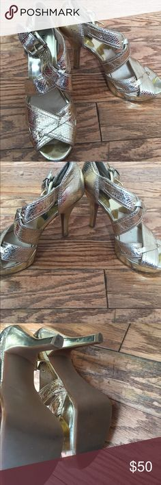 Michael Kors gold metallic heels shoes 8 Preowned Michael Kors gold heels w python like detail. Size 8m. Adjustable buckles. Some minor wear and scuffs throughout but still looks so chic! Michael Kors Shoes Heels