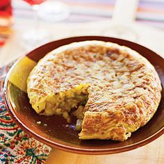 Tortilla Española | MyRecipes.com  with yukon golds, onion, eggs  serve as an appetizer or main course
