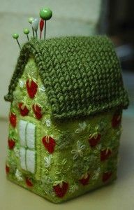 green strawberry pincushion house