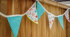 Make sure your garden is summer ready, with this easy to sew bunting, complete with pom pom trim!