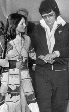 Elvis and Priscilla Presley in Los Angeles on the day their divorce was decreed.