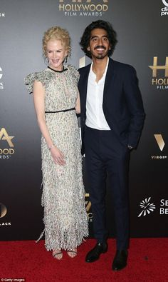 Gorgeous: The wowed in an exquisite, delicate gown with ruffled sleeves and a peep-hole cut out Dev Patel, Formal Men Outfit, Ladies Gents, Red Suit, Film Awards, Shoulder Length Hair, Nicole Kidman, Celebrity Style