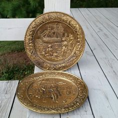 Check out this item in my Etsy shop https://www.etsy.com/listing/470776990/brass-ornate-wall-plates-ship-scenes