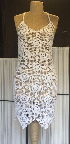A white dress with floral patterns. This dress was made with beach clothing in mind but can be worn on any occasion you might see fit. Made with 100% microfiber acrylic. Size for this product is M but due to the material used and the type of the crochet, it is quite elastic and fits