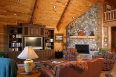 Hybrid Log Home Great Room And Stone Fireplace In A Golden Eagle Log Home