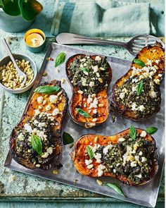 An impressive vegetarian main that sees sweet and caramelised butternut squash stuffed with uber cheesy pesto rice and then scattered with extra feta and pine nuts. Rice Recipes, Vegetable Recipes, Vegetarian Recipes, Cooking Recipes, Chicken Recipes, Recipies, Butternut Squash Soup, Roasted Butternut, A Food