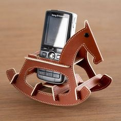 Rocking Horse Phone Holder Brown, $26.75, now featured on Fab. Cute, strange, fun.