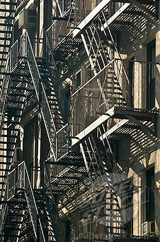 REPINNED from Sarah - Whenever I go to Chicago, I can't help but feel disgust towards the massive overuse of iron fire stairs. If there is a fire, wouldn't the iron begin to heat and melt? Also, iron is electro conductive. What else can we do to safely evacuate a building? There must be a better idea than this.