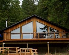 Beautiful Lake House offers a great view from the deck and a private boat dock www.wallowalakevacationrentals.com
