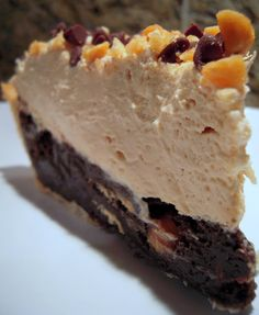 Mile-High Peanut Butter Pie. Best pie ever.  The fudge brownie layer is amazing.