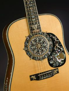 Martin 1,000,000th guitar with ornate inlays by Larry Robinson