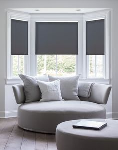 Serena Daybreak style roller shades shown in Gray make this white room pop
