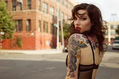I WISH I COULD SEE THE DETAIL...IF I WAS THINNER I WOULD SOOO GET A SLEEVE ON ONE ARM ATLEAST HER TATS ARE BEAUTIFUL