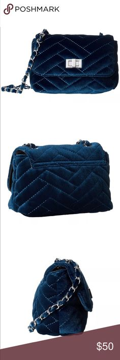 NWTORIGINAL By Steve Madden  Bluevelvet Bchant Bag Sprinkle a lovely dash of elegance on your cool look with Steve Madden Bachant Bag.                                     Product Information:Made with quilted velvet , Flap with turn - lock closure, chained crossbody bag,Flat bottom, lined interior, Interior back wall zip pocket, Imported.           Measurements:Bottom width : 6 inches . Depth : 3 inches . Height : 5 inches. Strap length:48 inches. Strap drop :23 inches. Steve Madden Bags…