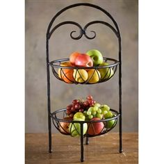 This lovely fruit stand allows you to transform storage necessities into lovely centerpieces. Two levels provide ample space for a variety of fruits, and the hand forged wrought iron's detailing provides plenty of interest. Tropical Kitchen, Fruit Storage, Hanger Crafts, Fruit Stands, Variety Of Fruits, Iron Furniture, Mixed Fruit, Wooden Crafts, Siena