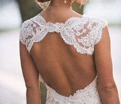 lace wedding dress with sleeves and an open back weddings