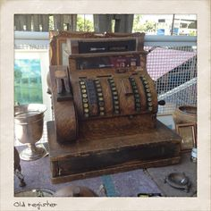 vintage cash register at a flea market in Rio