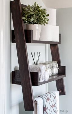 This is the perfect twist to the floating shelf and the ladder shelf! DIY floating ladder shelf with a towel bar! This is the perfect twist to the floating shelf and the ladder shelf! DIY floating ladder shelf with a towel bar! Floating Shelves Bathroom, Floating Wall, Bathroom Shelves Over Toilet, Bathroom Ladder Shelf, Above The Toilet Storage, Ladder Shelf Decor, Over The Toilet Ladder, Bathroom Towel Storage, Bathroom Stand