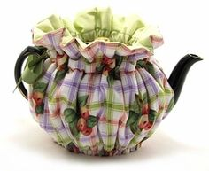 Our Spring Orchard Teapot Cozy is a delightful plaid pattern perfect for keeping tea warm in a 2 Cup teapot.  It is finished with cotton and polyester batting and non-fraying grosgrain ribbon.