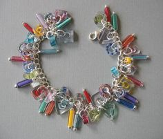 Items similar to Small Tubes and Slices Multicolor Furnace Glass, Cane Glass Charm Bracelet on Etsy Glass Jewelry, Charm Jewelry, Beaded Jewelry, Glass Beads, Jewelry Bracelets, Silver Jewelry, Diy Bracelet, Diy Jewellery, Necklaces