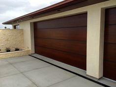African Mahogany Contemporary Wood Garage Door With Anodized Aluminum Bands Tungsten Royce 1
