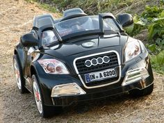 Black Audi TT Kids Electric 6v Roadster. Totally think the girls need this next year for Christmas.