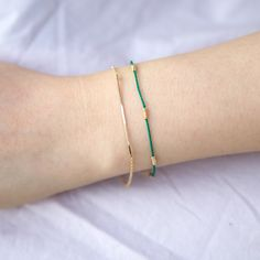 Classic, delicate and sophisticated silk bracelet. Subtle colors are nice to match and layer with other bracelets. Handmade in Brooklyn Jewelry Companies, Geometric Shapes, Brooklyn, Personal Style, Delicate, Silk, Colors, Classic, Unique