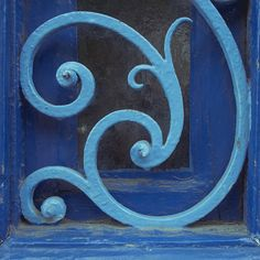 scroll ironwork painted blue