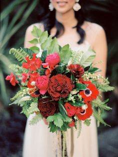Huge Red Wedding Bouquet - See more of the wedding here: http://www.StyleMePretty.com/2014/05/15/whimsical-downtown-los-angeles-wedding/ #SMP - Photography: AshleyKelemen.com  - Floral Design: SweetMarieDesigns.com