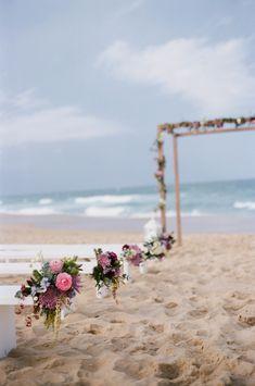 Beach Weddings: Aisle Decor | Photography: Ale & Kim Photogrphy | On SMP: australia-weddings/queensland-au/sunshine-coast/2013/11/26/sunshine-coast-beach-elopement-inspiration-from-little-owl-events-ale-kim-photography