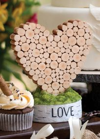 Add a natural accent to your rustic wedding with this heart, which is made of resin but looks like real wood stacked together! The heart stands on a birch bark-style base. Style DBK20762 #davidsbridal #weddingdecor #rusticweddings