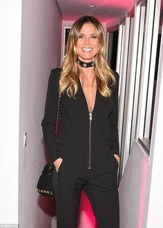 Details: The 43-year-old America's Got Talent host wore a fun choker and matching purse...