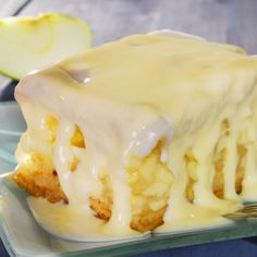 A warm and yummy recipe for apple cake with a sweet vanilla cream sauce.