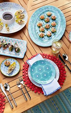 Add a pop of color—expressed in vibrant patterns—to your dinner table with our fun Kavala Dinnerware. | Frontgate: Live Beautifully Outdoors