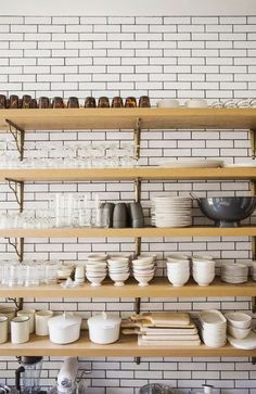 brass brackets + open wood shelves in the kitchen