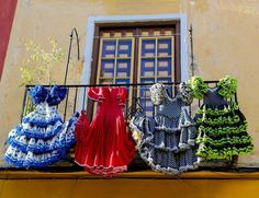 Traditional flamenco dresses at a house in Malaga, Andalusia   Spain Travel Guide