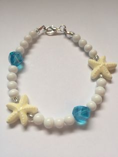 A personal favorite from my Etsy shop https://www.etsy.com/listing/292101773/white-starfish-crystal-mermaid-beach