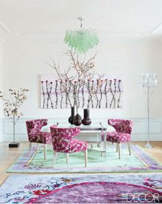 Gorgeous colors and shapes in this dining room. Wow, that chandelier and those chairs! Not kid friendly though.