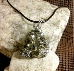 Pyrite stone pendant wrapped with sterling silver by BerlyDesigns