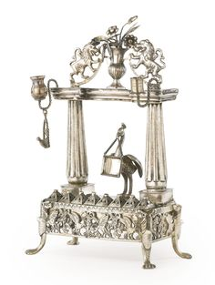 A silver portico and peacock Hanukah lamp, 19th century | Lot | Sotheby's