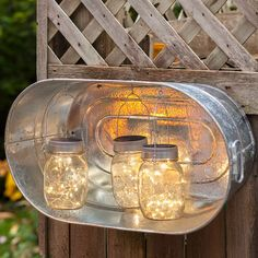 Hook solar LED jar lights to the inside of a galvanized oval tub for a festive DIY lantern. Then hang the tub on a fence, wall, or gate. Recharge the jar lights in a sunny spot in the tub or remove them and replace them at night.