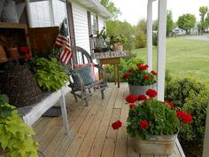 country porch love the wash tub planters! Have some in the barn, need to get them out!