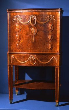 Cabinet for botanical specimens, English, c.1780  Mary Eleanor Bowes, Countess of Strathmore and grandmother of John Bowes, was a keen collector of plants; this cabinet was made to house her collection. When the front side cover is lowered, the interior reveals drawers to store plant specimens, with a tilting panel on which to inspect the specimens or use as a writing stand. A drainage system allowed the plants to be kept watered.  It is veneered in burr elm and kingwood on oak, with…
