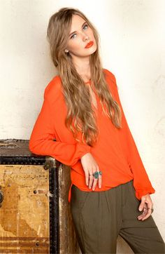 Orange, olive, and turquoise. Orange lips put this outfit over the top!