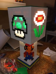 Hey, I found this really awesome Etsy listing at https://www.etsy.com/listing/196992375/mario-brothers-themed-lego-lamp