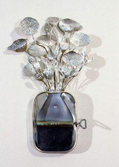 Fiona Hall | 'Paradisus Terrestris - Nelumbo Nucifera/Lotus' (1998). Tin, aluminium.