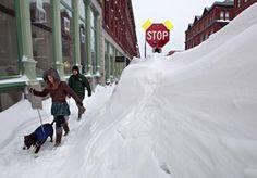 Image: A couple walks past a large snow drift in Portland, Maine (© Robert F. Bukaty/AP)
