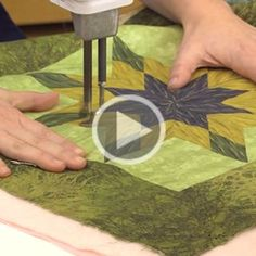 Angela Walters gives some tips on how to quilt you blocks and demonstrates the continuous curve design.