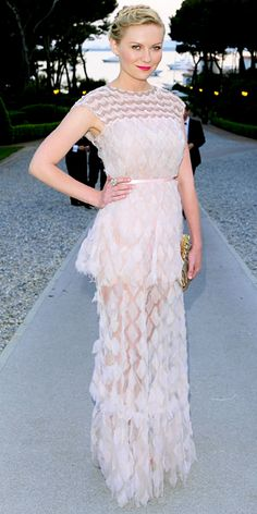 Dunst stepped out in a pastel Chanel Haute Couture confection and an embellished clutch.